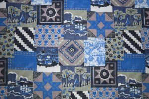 blue-patchwork-quilt-fabric-texture